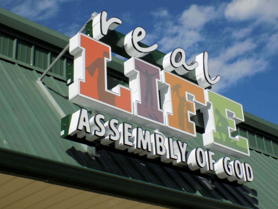 Real Life Assembly of God channel letter sign with colorful sign faces