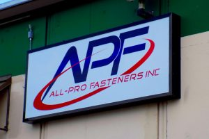 Wall-mounted lighted cabinet sign for All-Pro Fastners Inc Kansas City MO